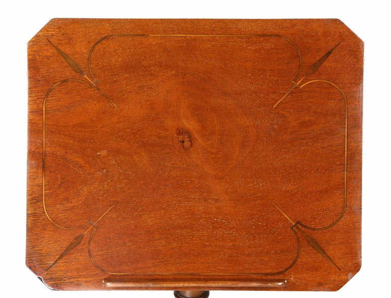 Rectangular adjustable top over a turned support with drawer,. raised on tripartite base.