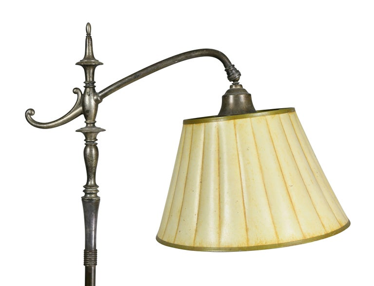 Bridge lamp form with circular base decorated with a greyish vine decoration.
