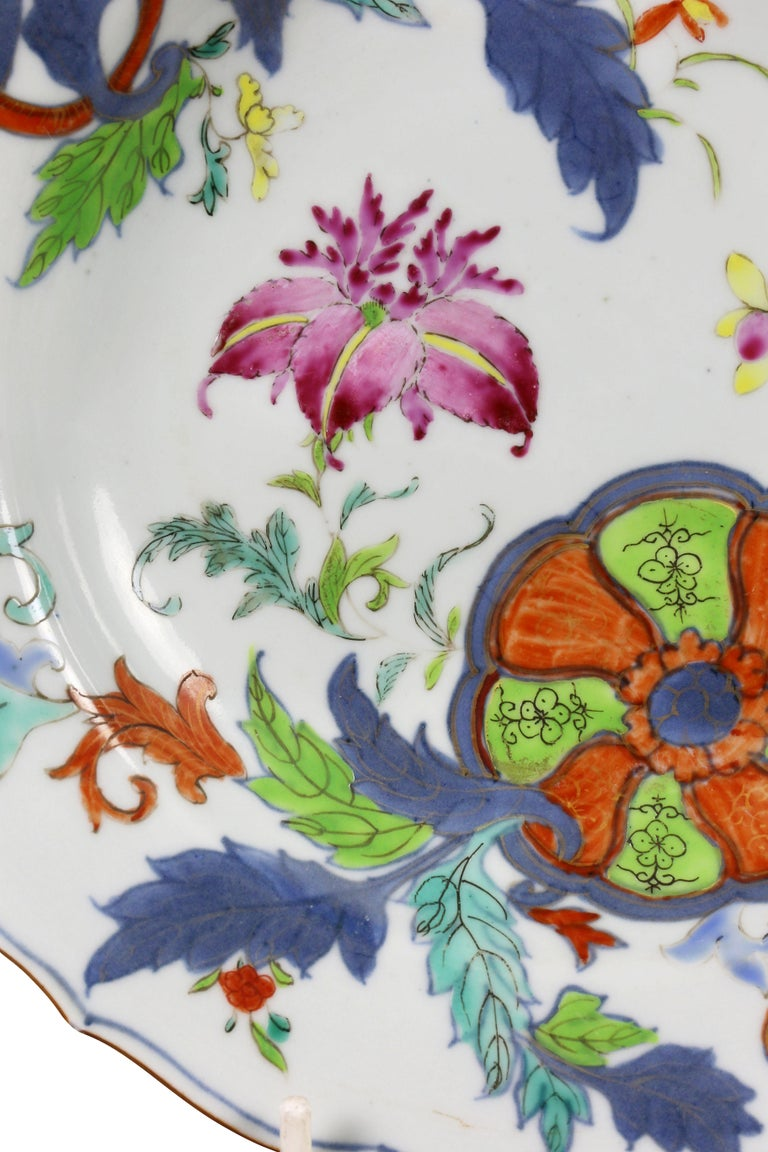 Each with a shaped rim with typical floral and leaf decoration. Brown glaze on rim edge. Blue is a paler shade than typical.
