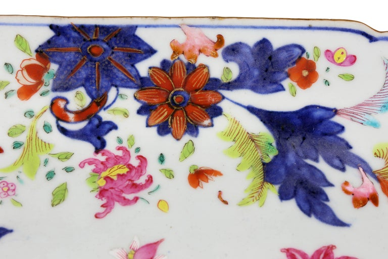 Decorated in blues and greens and reds in floral pattern.