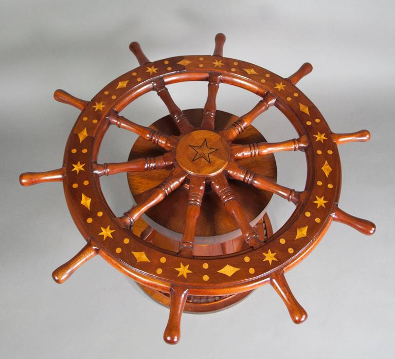 This nautical ships wheel coffee table is no longer available