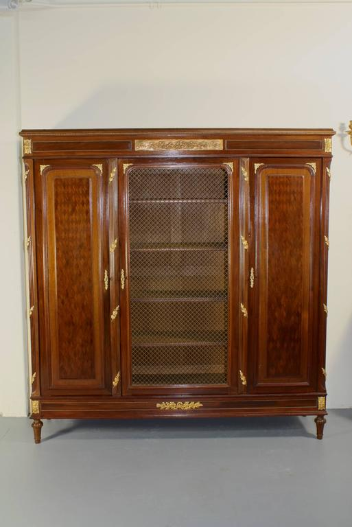 Gilt French Louis XVI Style Mahogany Bibliotheque For Sale