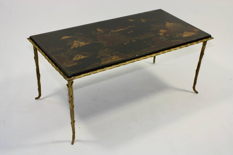 French black lacquered and japanned coffee table with gilt bronze mounts, acanthus detailing (Maison Baguès, mid-20th century).