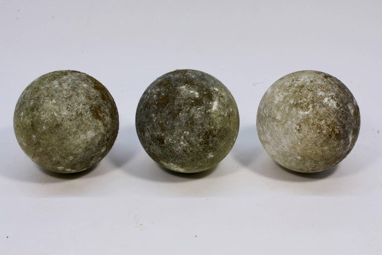 Set of three large French 19th century carved stone ball finials or garden elements (possibly cast stone). Could be used as finials on a gate pillars or a wall, or as interesting garden ornaments. Each sphere weighs approximately 50 lbs.