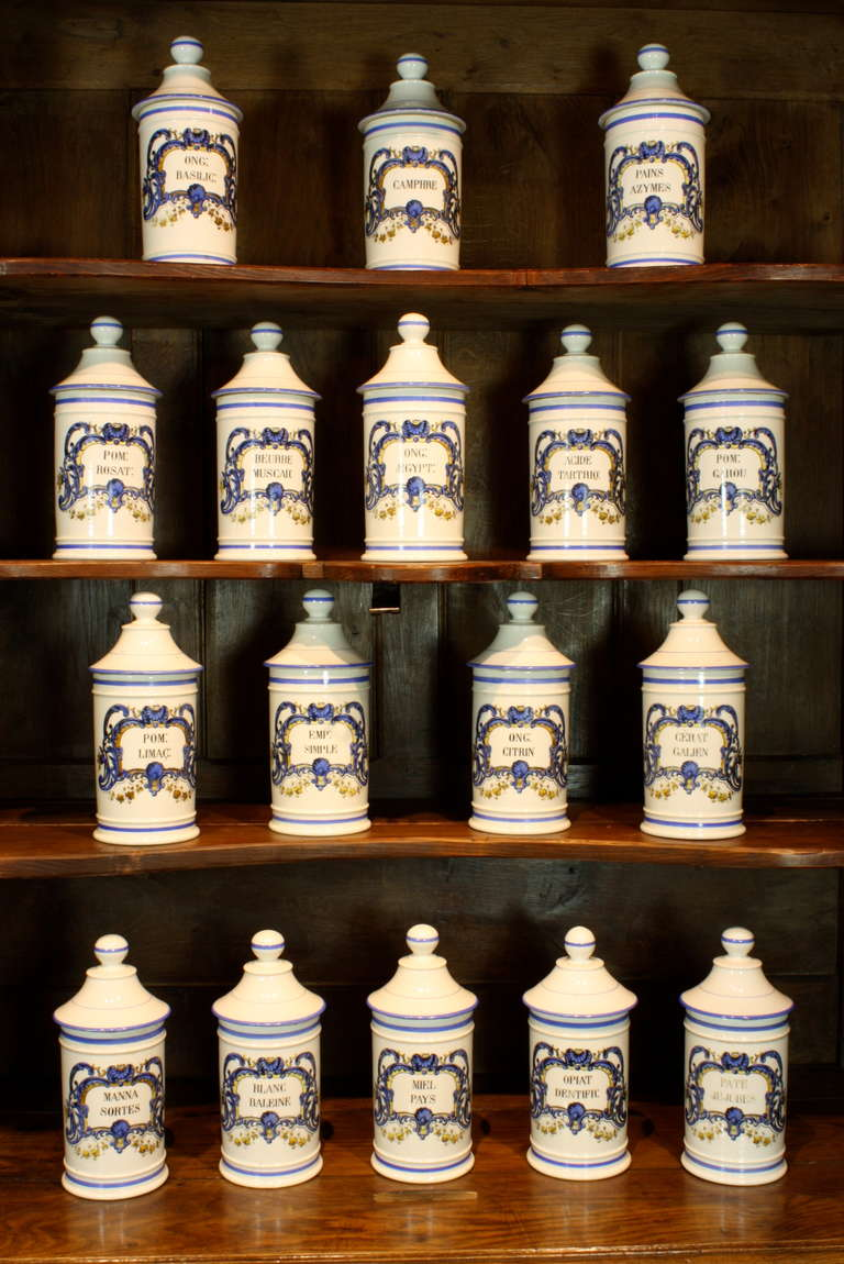 A beautiful and rare set of high-quality 17 hand-painted French apothecary jars, each with a different label, painted in a Régence style in blue and yellow, with separate domed lid (Circa 1880). Marked underneath,