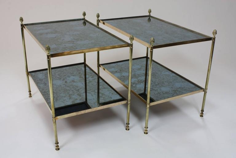 A Pair Of French Silvered Brass And Eglomise Glass Top Side Tables With Two  Tiers