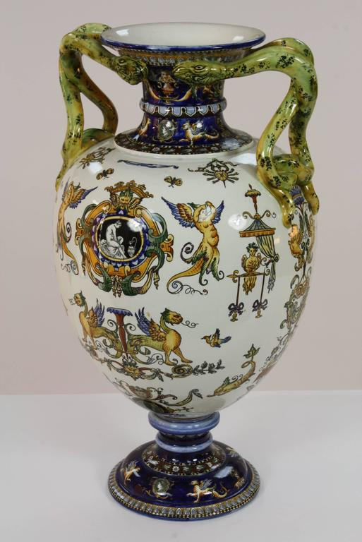 An highly-detailed and impressive French faience two-handled vase by Gien, in the