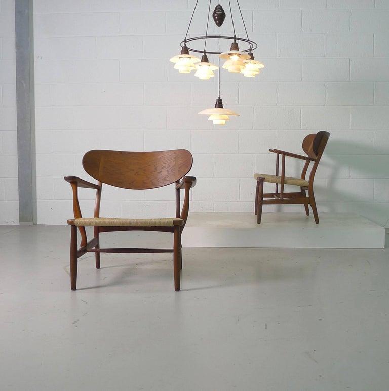 Danish Hans Wegner for Carl Hansen, Denmark, Pair of CH22 Armchairs, 1950s For Sale