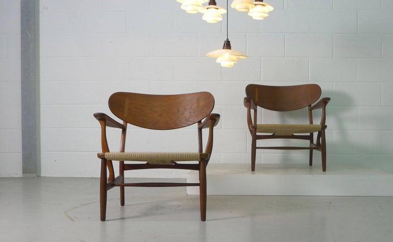 Mid-Century Modern Hans Wegner for Carl Hansen, Denmark, Pair of CH22 Armchairs, 1950s For Sale