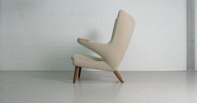 Hans Wegner Papa Bear chair for AP Stolen, Denmark, 1951. Classic early production armchair recently reupholstered in beige/cream Kavadrat wool fabric , oak paws and legs , underside of front stretcher stamped by maker.