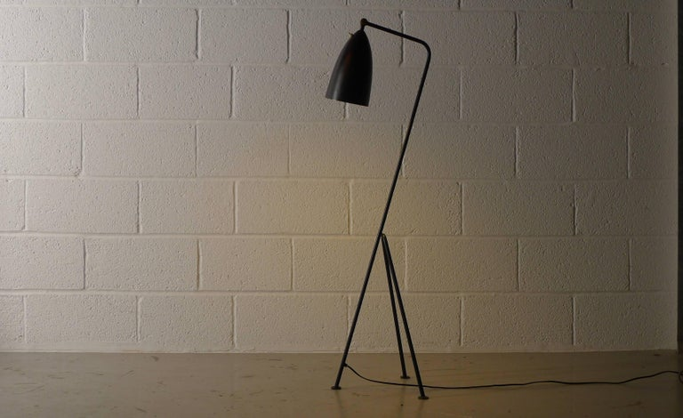 Greta Magnusson-Grossman for Bergboms, Malmo, Sweden. Model G-33 floor lamp with adjustable conical shade on tripod base, black enameled steel and brass fittings.