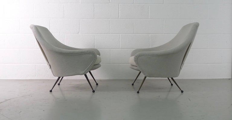 Marco Zanuso for Arflex, Italy, 1954. A pair of Martingala armchairs, fully refurbished after being stripped back to the framework , new soft grey linen upholstery with contrasting cream seats and curtain backs.  Priced for the pair.