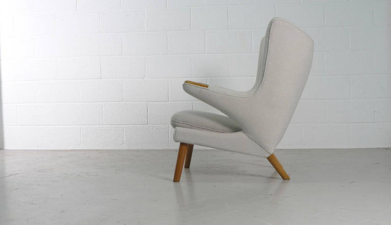 Hans Wegner, 1951 design for AP Stolen, Denmark. The iconic Papa Bear chair, newly reupholstered and refurbished in cream or grey Kvadrat fabrics.