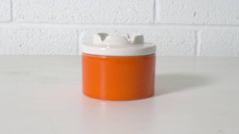 Ettore Sottsass, Italy, two-piece orange and white ceramic ashtray from his designs for Il Sestante circa 1962. Signed to underside with model number 604.   Perfect condition.  Documented by Fulvio Ferrari, Ettore Sottsass; Tutta la Ceramica.