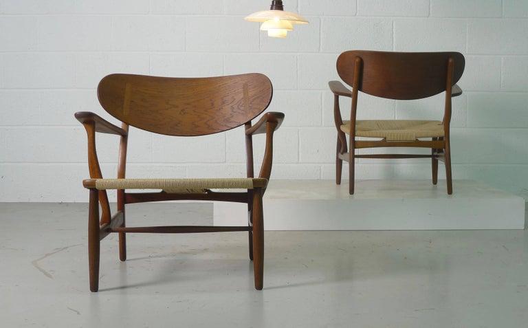 Mid-20th Century Hans Wegner for Carl Hansen, Denmark, Pair of CH22 Armchairs, 1950s For Sale