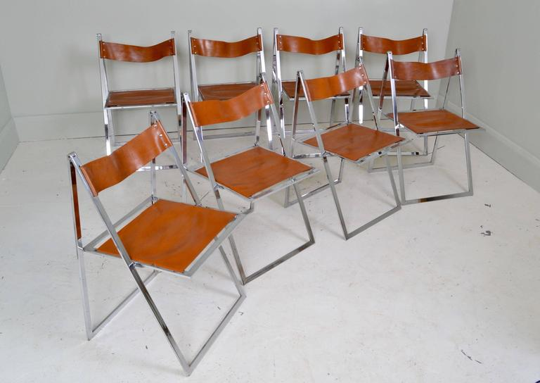 Set of eight leather and chrome vono lubke dining chairs