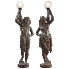 Pair of French Cast Iron Figural Sculptures of Torch Bearers, circa 1880