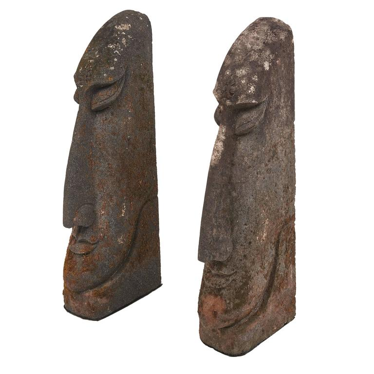 Pair of carved stone easter island heads south sea