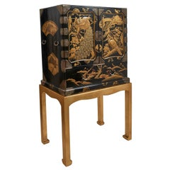Japanese Lacquered Cabinet on Stand with Gilt Relief Decoration, circa 1890