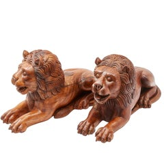 Pair of Indian Carved Teak Recumbent Lions Architectural Elements, circa 1900