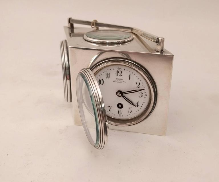 French diamond shaped silver clock with a barometer, temperature gauges in Fahrenheit and Celsius. Topped with a compass and an angular handle to match the shape of the body. Comprising a desk clock, barometer, both Fahrenheit and Centigrade