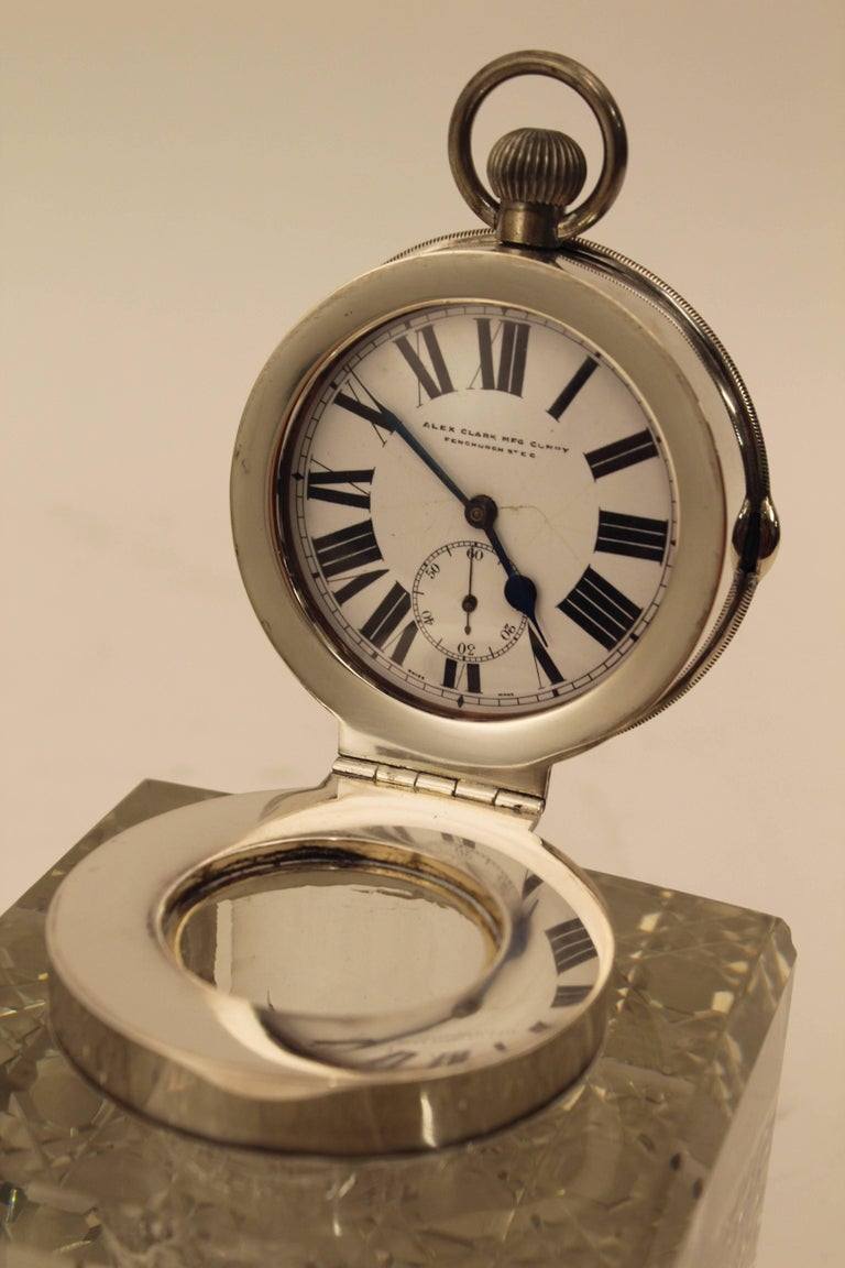 Edwardian silver mounted clock inkwell, on a heavy square crystal base, the bottom with a geometric hobnail cut. The clock on the inside of the silver inkwell lid, made by the Alexander Clark Manufacturing Company. The silver mounts Hallmarked