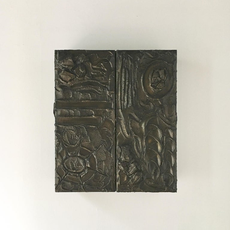 Sculpted bronzed resin Paul Evans designed two door wall hung cabinet signed and dated PE70 1970. Part of his bronze 100 series for directional, wooden carcass with Evans