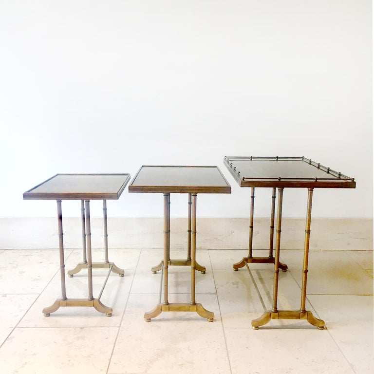 Set of three nesting tables made of faux bamboo with tray type tops with brass bars, trims and pull details, 1960s.