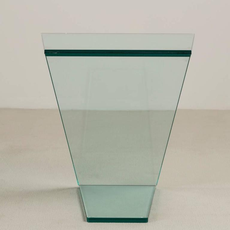 A cantilevered sculptural glass side table