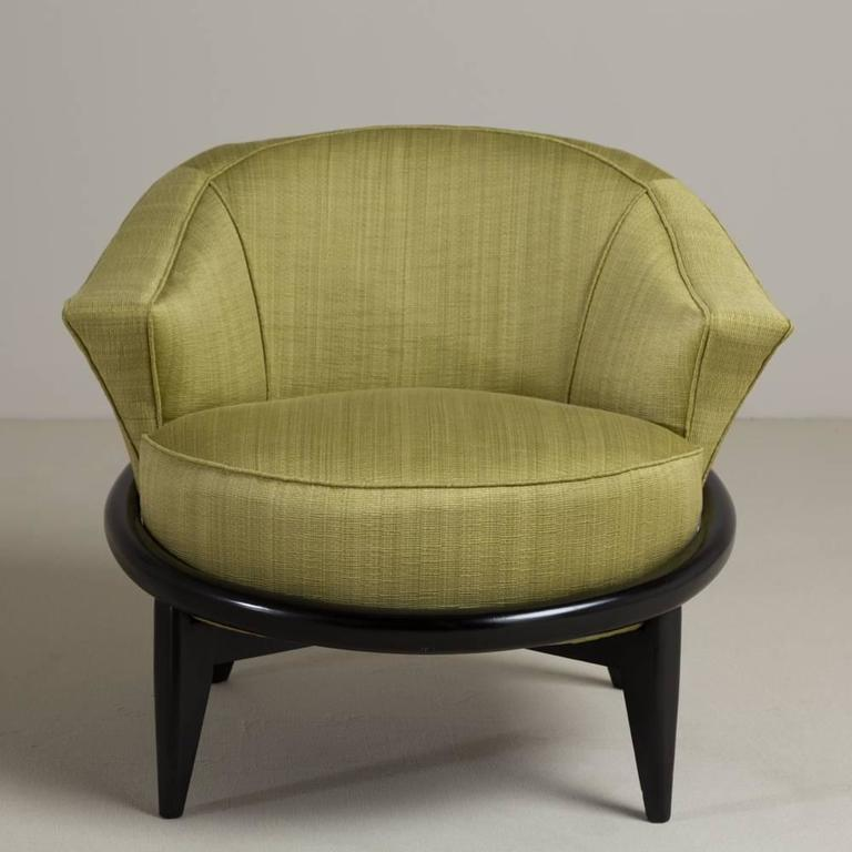 A single ebonized framed upholstered armchair reupholstered by Talisman.