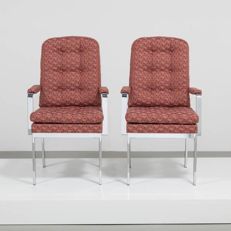 A pair of Milo Baughman designed chromium steel framed high backed upholstered chairs 1970s fully reupholstered by Talisman.