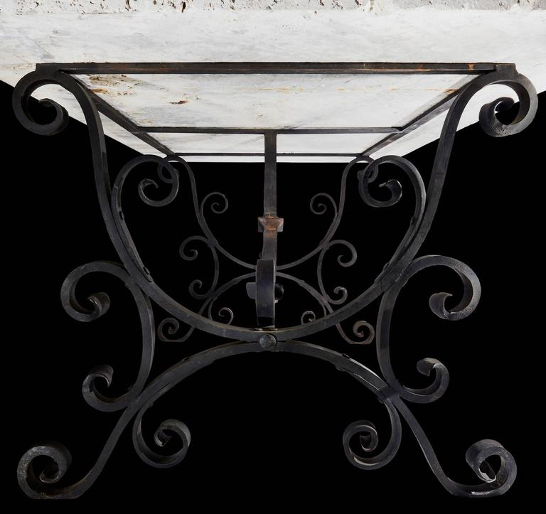 One of the most fabulous tables we've ever had the pleasure of selling. The base is hand-wrought and riveted iron circa 1890. The top is the most amazing piece of coral I have ever seen, and a material I have never seen used as a tabletop.