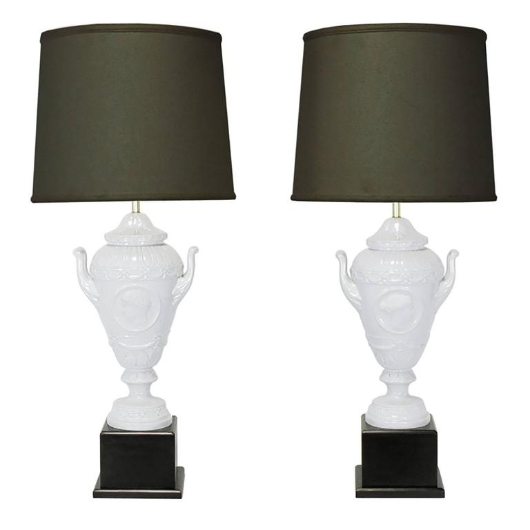 Pair of White Porcelain Urn Table Lamps with Male and Female Busts in Relief For Sale