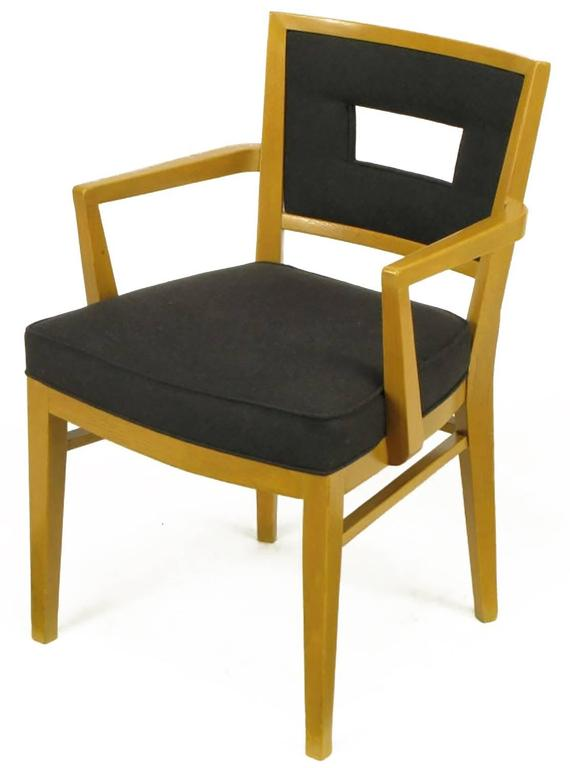 Set of eight white oak clean lined dining chairs with new black flannel upholstery. Manufacturer is undetermined, but build quality is on par with Edward Wormley for Dunbar or T.H. Robsjohn-Gibbings for Widdicomb. Thick padded and sprung set
