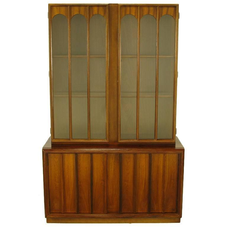 Keller Colonnade Top Walnut And Glass Tall Cabinet For Sale