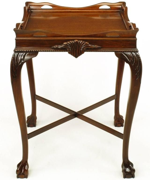 Expertly carved mahogany ball and claw footed tables in the style of George ll.
