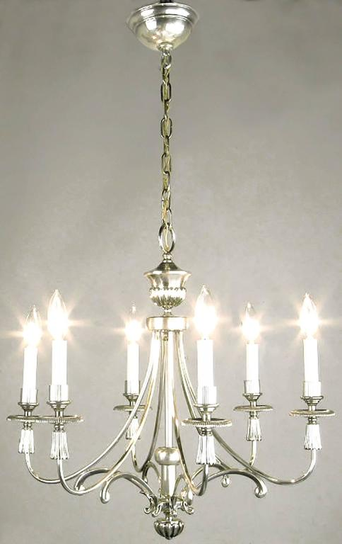 Silver-plated six-arm Regency chandelier from Lightolier. Certain characteristics are similar to the design elements of Parzinger's work for Lightolier. Specifically, the silver table lamps and table top torcheres Lightolier marketed in the 1950s.