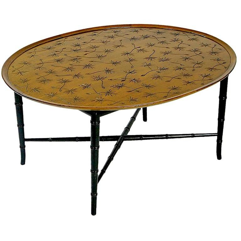 An Elegant Oval Mahogany Coffee Table By Kittinger The Raised Edge Surrounds A Flat Center