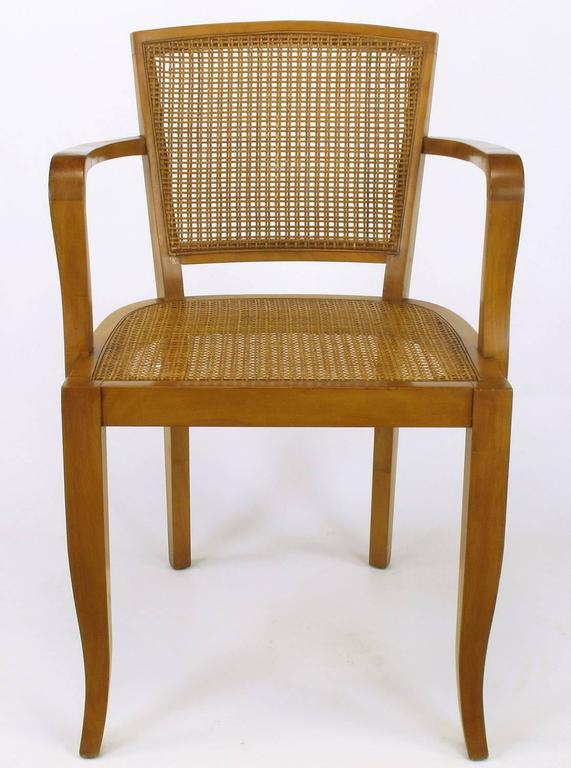 Expertly designed and constructed cherrywood armchairs with tight Danish weave cane seats and backs. Saber front legs and slightly raked back legs. Sturdy and strong chairs with multiple applications.