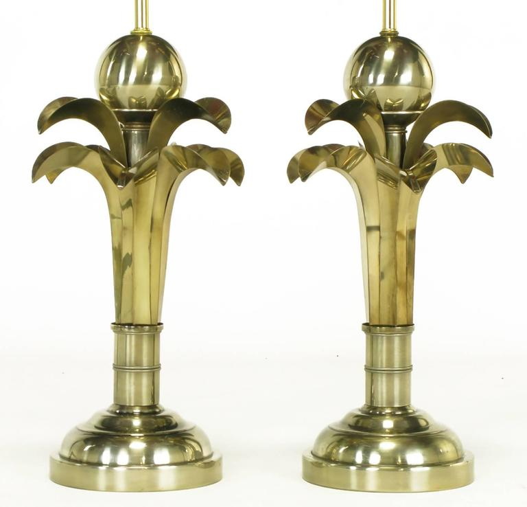 Pair of stylized palm tree table lamps in gold metal in the manner of Maison Charles. Half sphere bases, large stylized bamboo stem, two layers of
