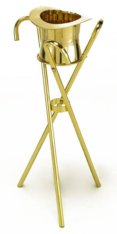 Unique and inspired champagne cooler or ice bucket on three canes in tripodal form stand. Solid brass top hat and brass-plated canes.