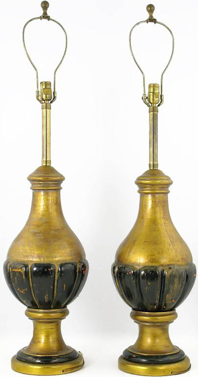 Pair of substantial table lamps by Marbro. Wonderfully distressed from natural use, the gilt and painted wood gourd-form bodies have a patina that only age can bring. Sold sans shades.