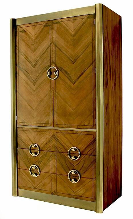 Mastercraft tall wardrobe with patinated brass details. Striking parquetry zebrano wood front in a zig zag pattern. Three lower drawers with upper open, single shelved section. Brushed and patinated demi-octagonal brass side pillars, brass panels to