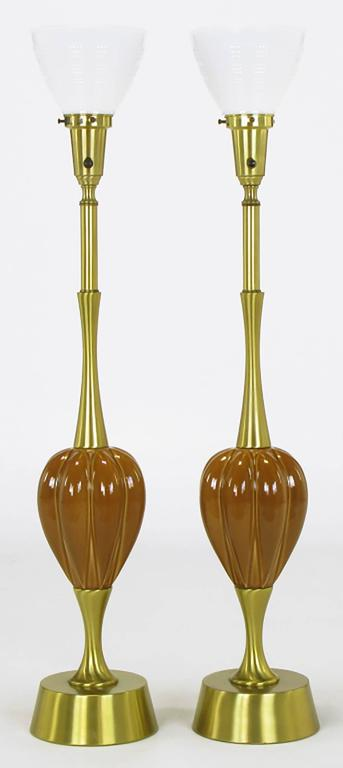 Pair of sizable brushed brass and umber ceramic inverted gourd form bodied table lamps by Rembrandt Lamp Company. Sleek and minimal base, stems and richly glazed ceramic gourd form body with milk glass diffusers.