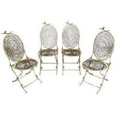 Four Iron Faux Bois Folding Chairs with Bird Nest Seats and Backs