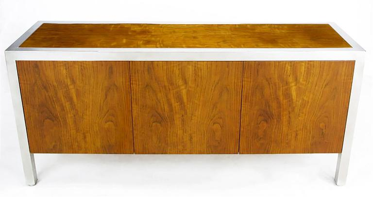 Rare Pace Collection sideboard/cabinet in highly figured and iridescent fiddleback koa wood. Heavy polished steel frame supports the cabinet on every side with parsons style simplicity. Beautiful wood grain with an iridescent property that reveals