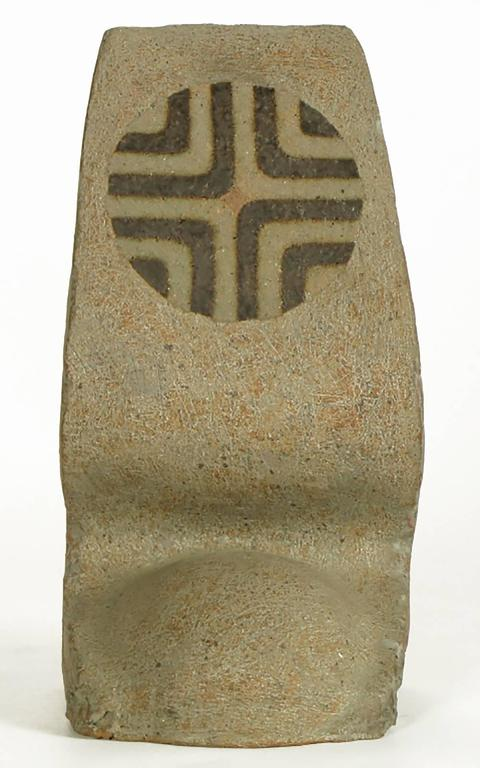 Heathered earthen glazed terra cotta sculpture by Tomiya Matsuda (1939-2011). A sinuous abstract shape with unfinished sides and half round base. Geometric top circular detail. Tomiya Matsuda (1939-2011) studied at the Kyoto University during the