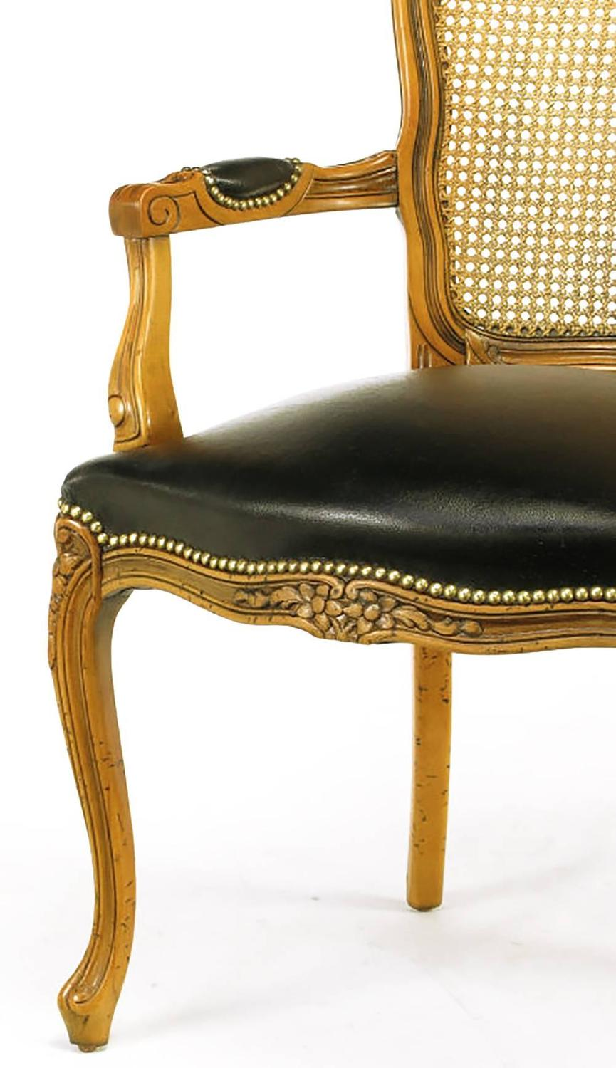 Four italian carved wood and black leather armchairs for