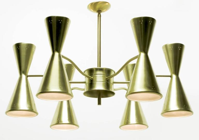 Twelve-light six-arm chandelier by Litecraft of California, circa 1950s. Gold anodized aluminium hourglass shades with upper and lower sockets, pierced triangular design and grey enameled interiors.