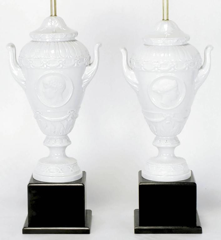 German Pair of White Porcelain Urn Table Lamps with Male and Female Busts in Relief For Sale